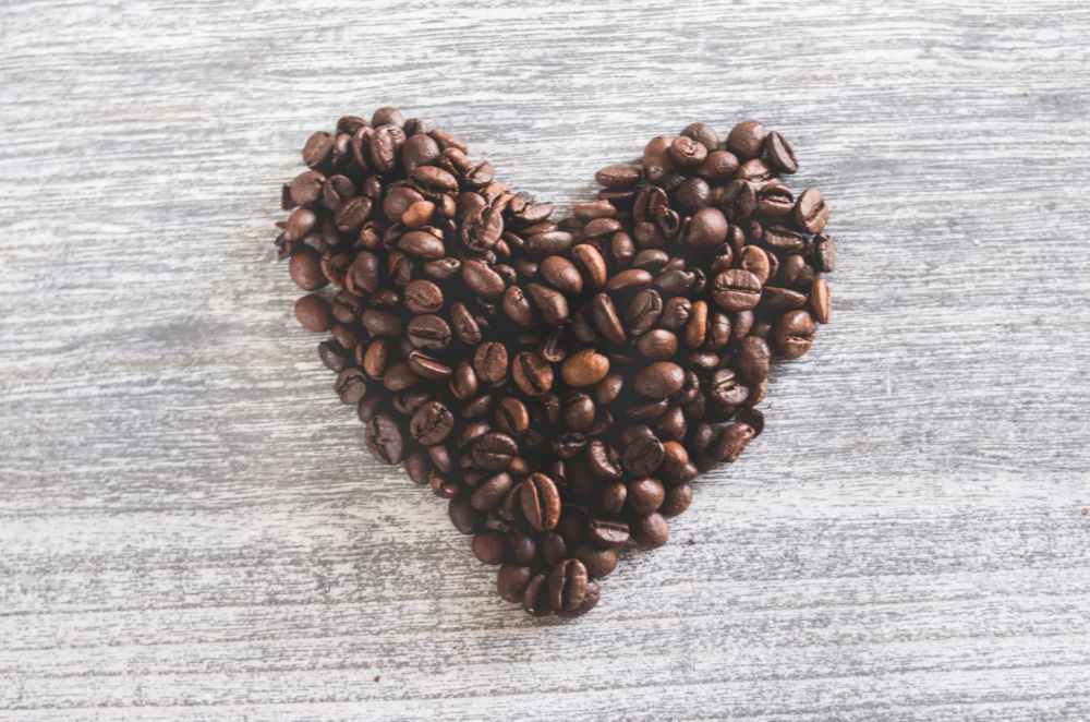 flatlay photo of heart shaped coffee beans
