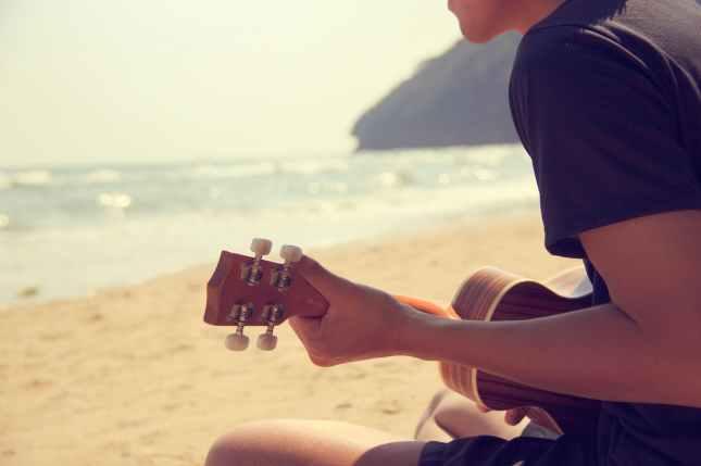 acoustic background beach guitarist